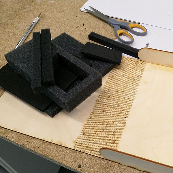 Cut foam inserts ready to be glued into place inside the assembled wooden box