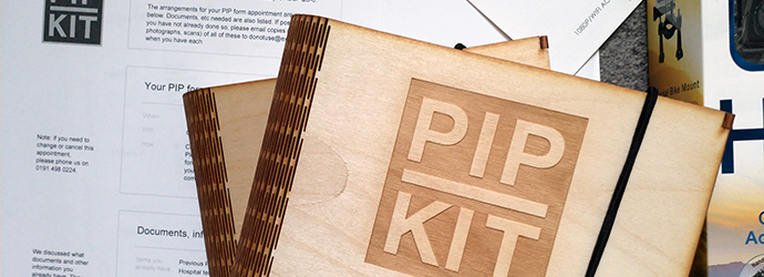 PIP Kit wooden boxes and print-outs of the paper version of PIP Kit as a Service